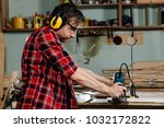 carpenter working of manual... | Shutterstock . vector #1032172822