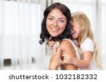 happy mother and child girl | Shutterstock . vector #1032182332