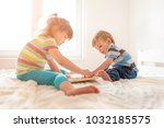 little boy and girl playing... | Shutterstock . vector #1032185575