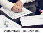 woman fills the tax form ... | Shutterstock . vector #1032206188