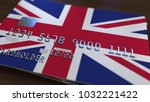 plastic bank card featuring... | Shutterstock . vector #1032221422