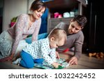 young parents play with their... | Shutterstock . vector #1032242452