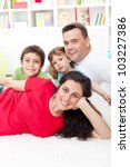 Young family portrait in their home - focus on the woman - stock photo