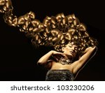 Attractive woman with gold hair - stock photo