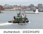 Small photo of New Bedford, Massachusetts, USA - February 22, 2018: Tug Bucky towing barge into New Bedford inner harbor