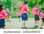 happy kindergarten students are ... | Shutterstock . vector #1032350572