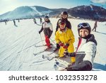 group of friends with ski on... | Shutterstock . vector #1032353278