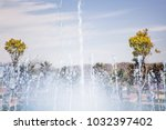 splashes of fountain water in a ... | Shutterstock . vector #1032397402
