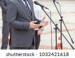politician is giving a speech.... | Shutterstock . vector #1032421618