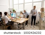 young and senior employees...   Shutterstock . vector #1032426232