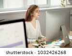 attractive focused female... | Shutterstock . vector #1032426268