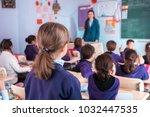 school children are... | Shutterstock . vector #1032447535