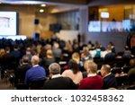 speaker on the podium. people... | Shutterstock . vector #1032458362