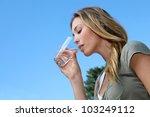 closeup of blond woman drinking ... | Shutterstock . vector #103249112