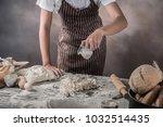 man preparing buns at table in... | Shutterstock . vector #1032514435