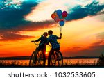 silhouette of two people on... | Shutterstock . vector #1032533605