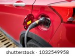 electric cars are charging at... | Shutterstock . vector #1032549958