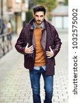 attractive young man walking in ... | Shutterstock . vector #1032575002