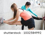 sportswomen stretching after... | Shutterstock . vector #1032584992