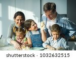 large family prepares something ... | Shutterstock . vector #1032632515