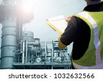 young engineer hand holding... | Shutterstock . vector #1032632566