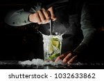 barman hand squeezing fresh... | Shutterstock . vector #1032633862