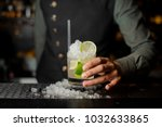barman hand holding a glass... | Shutterstock . vector #1032633865