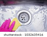 close up sink drain and hand... | Shutterstock . vector #1032635416