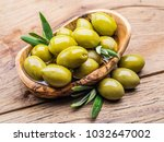 whole table olives in the... | Shutterstock . vector #1032647002