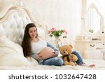 pregnant girl in the seventh... | Shutterstock . vector #1032647428