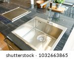 stainless kitchen sink and tap... | Shutterstock . vector #1032663865