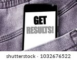 Small photo of Hand writing text caption inspiration showing Get Results. Business concept for Achieve Result written mobile cell phone with space in the back pants trousers pocket