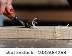 close up carpenter woman's hand ... | Shutterstock . vector #1032684268
