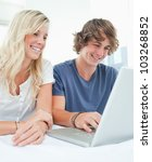 a couple using a laptop to surf ... | Shutterstock . vector #103268852