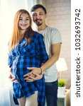 man and a pregnant young woman... | Shutterstock . vector #1032693742
