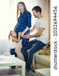 a family of three. pregnant mom ... | Shutterstock . vector #1032694456
