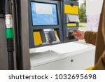 self service filling station.... | Shutterstock . vector #1032695698