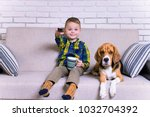 funny boy with remote control... | Shutterstock . vector #1032704392