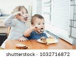children in the kitchen eat... | Shutterstock . vector #1032716872
