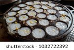 thai coconut pudding cooked in...   Shutterstock . vector #1032722392