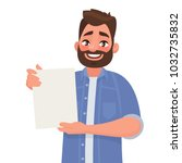man shows a sheet with the... | Shutterstock .eps vector #1032735832