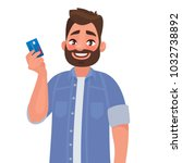 man holds a credit card in his... | Shutterstock .eps vector #1032738892