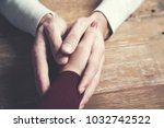 woman and  man hand on wooden ... | Shutterstock . vector #1032742522