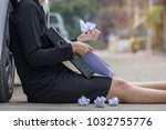 Small photo of Businesswoman sits and holding folder of document file with scrap paper after cancel a job. Failure and lack of morale. Soft focus and blur. Copy space.