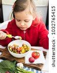 little vegan girl eating fresh...