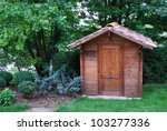Wooden Garden Tool Shed In A...