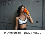 young sportswoman drink protein ... | Shutterstock . vector #1032775672