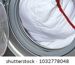 pillow in the washing machine.... | Shutterstock . vector #1032778048