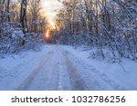 rustic road in winter. comana... | Shutterstock . vector #1032786256