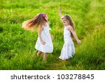 Two Adorable Girl In White...